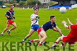 St Marys Darren Casey has a go at goal but strong defense by An Ghaeltacht's Cathal Ó Luing and keeper Tomás Mac an tSaoir concede only the point.