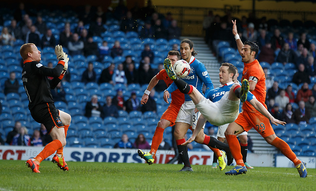 Jon Daly tries to beat keeper Craig Samson with an acrobatic effort