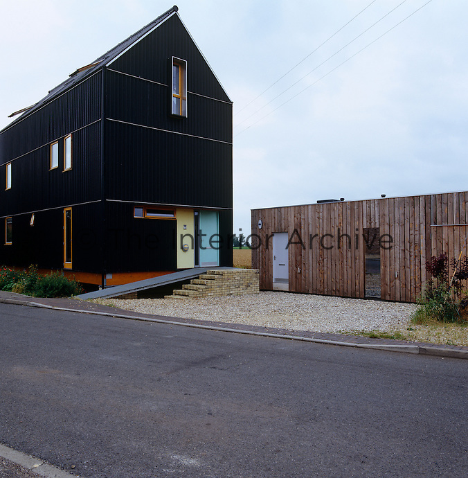 Built on stilts, the architect Meredith Bowles's Black House looks like a modern reinvention of the timber farm buildings in the area, the black coat echoing their bitumen finish