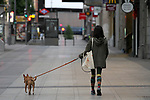 A woman walks her dog down Gran Via in Madrid during the health crisis due to the Covid-19 virus pandemic - Coronaviruss. April 27,2020. (ALTERPHOTOS/Alejandro de Dios)