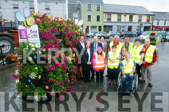 Killorglin Tidy Towns have set up a new bee cafe in Library Place. Pictured l-r Linda O'Leary, AIB, Nula Ward, AIB, David Brooks, Tidy Towns, Trudy O'Sullivan, Tidy Towns, Natalie O Sullivan, Tidy Towns, Breda O'Sullivan, Terence  O'Sullivan, St. John of God, Brian Looney, Tidy Towns, Brendan Foley, Tidy Towns, Orna Eccles, Tidy Towns,  Michael Kenny, Tidy Towns