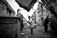 "Nagorny-Karabach, 23.05.2011, Shushi. Khachik (m.) und seine Kollegen von der M¸llabfuhr sammeln den Abfall der Stadt ein. ""The Twentieth Spring"" - ein Portrait der s¸dkaukasischen Stadt Schuschi, 20 Jahre nach der Eroberung der Stadt durch armenische K?mpfer 1992 im B¸gerkrieg um die Unabh?ngigkeit Nagorny-Karabachs (1991-1994). Garbage collecter Khachik (c.) at work with his colleagues. ""The Twentieth Spring"" - A portrait of Shushi, a south caucasian town 20 years after its ""Liberation"" by armenian fighters during the civil war for independence of Nagorny-Karabakh (1991-1994)..L'éboueur Khachik travaillant avec ses collègues.""Le Vingtieme Anniversaire"" - Un portrait de Chouchi, une ville du Caucase du Sud 20 ans après sa «libération» par les combattants arméniens pendant la guerre civile pour l'indépendance du Haut-Karabakh (1991-1994).. © Timo Vogt/Est&Ost, NO MODEL RELEASE !!"