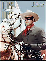 BNPS.co.uk (01202 558833)<br /> Pic: Julien'sAuctions/BNPS<br /> <br /> ****Please use full byline****<br /> <br /> The Lone Ranger wearing the mask. <br /> <br /> The iconic black mask worn by crime-busting Wild West hero The Lone Ranger has emerged for sale - with a whopping &pound;40,000 pounds price tag.<br /> <br /> The mask was one of three which were custom made for star actor Clayton Moore, who played the mysterious masked gunslinger in the 1950s TV show.<br /> <br /> It was Moore's favourite mask because of its comfortable fit and the clear view it offered him while performing his own stunts.
