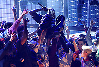 Travis Scott is carried during a performance at the 61st annual Grammy Awards on Sunday, Feb. 10, 2019, in Los Angeles. (Photo by Matt Sayles/Invision/AP)