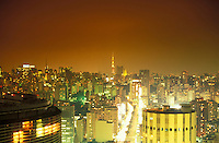 Sao Paulo cityscape at night - TV towers of Paulista Avenue ( Avenida Paulista ) in the background and downtown area in the foreground.