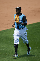 Syracuse Chiefs outfielder Tony Gwynn Jr. (18) jogs to the dugout during a game against the Pawtucket Red Sox on July 6, 2015 at NBT Bank Stadium in Syracuse, New York.  Syracuse defeated Pawtucket 3-2.  (Mike Janes/Four Seam Images)