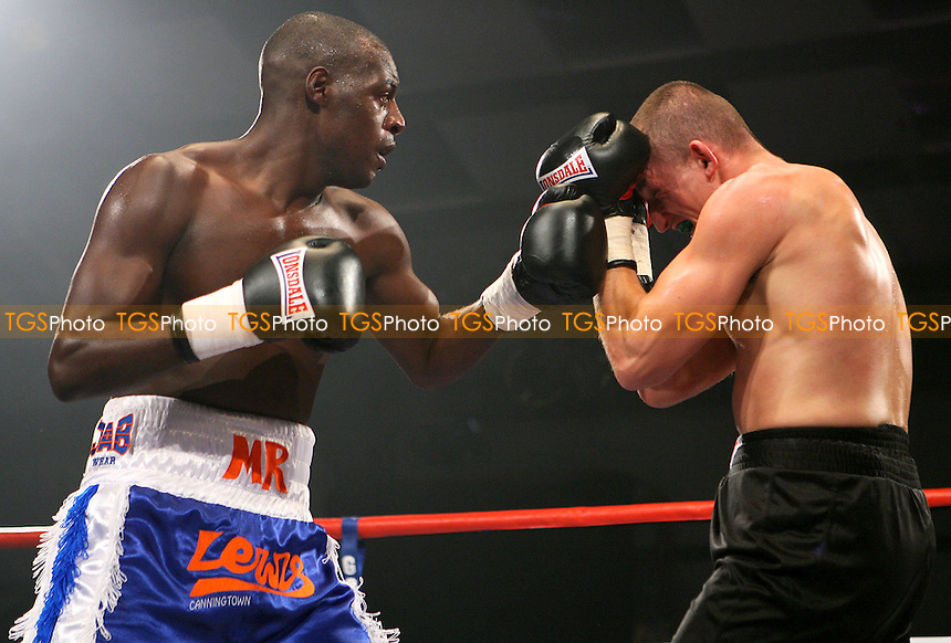 Dwayne Lewis (Canning Town, blue shorts) defeats Pawel Trebinksi (Tooting, black shorts) in a Super-Middleweight boxing contest at the Norfolk Showground, Norwich promoted by Hennessy Sports - 05/10/08 - MANDATORY CREDIT: Chris Royle/TGSPHOTO - Self billing applies where appropriate - 0845 094 6026 - contact@tgsphoto.co.uk - NO UNPAID USE.