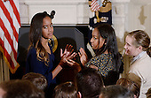 Malia Obama (L) and Sasha Obama look on during a ceremony to  presents the Medal of Freedom to Vice-President Biden in the State Dinning room of the White House, January 12, 2017 in Washington, DC. <br /> Credit: Olivier Douliery / Pool via CNP