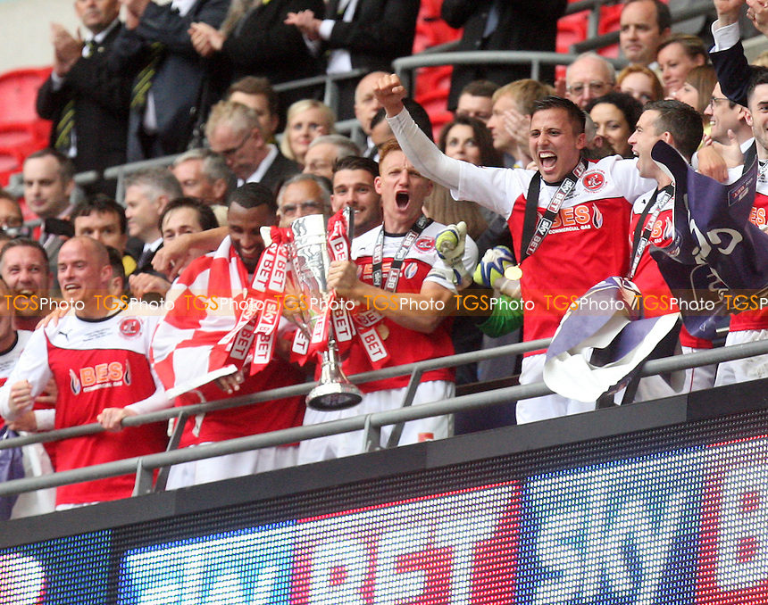 Mark Roberts of Fleetwood Town picks up the trophy - Burton Albion vs Fleetwood Town, Sky Bet Play Offs - League Two play off final Wembley Stadium - 26/05/14 - MANDATORY CREDIT: Dave Simpson/TGSPHOTO - Self billing applies where appropriate - 0845 094 6026 - contact@tgsphoto.co.uk - NO UNPAID USE