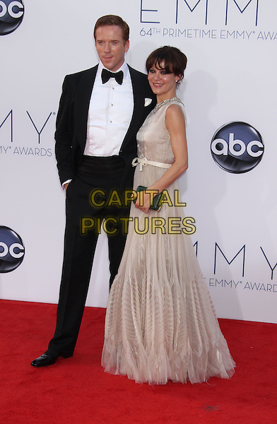 Damian Lewis, Helen McCrory.The 64th Annual Primetime Emmy Awards - Arrivals, held at Nokia Theatre L.A. Live in Los Angeles, California, USA..September 23rd, 2012.emmys full length black white tuxedo bow tie shirt beige dress side tulle married husband wife .CAP/ADM/RE.©Russ Elliot/AdMedia/Capital Pictures.