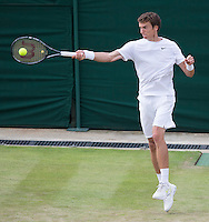 ANDREY KUZNETSOV (RUS)<br /> <br /> The Championships Wimbledon 2014 - The All England Lawn Tennis Club -  London - UK -  ATP - ITF - WTA-2014  - Grand Slam - Great Britain -  25th June 2014. <br /> <br /> &copy; AMN IMAGES