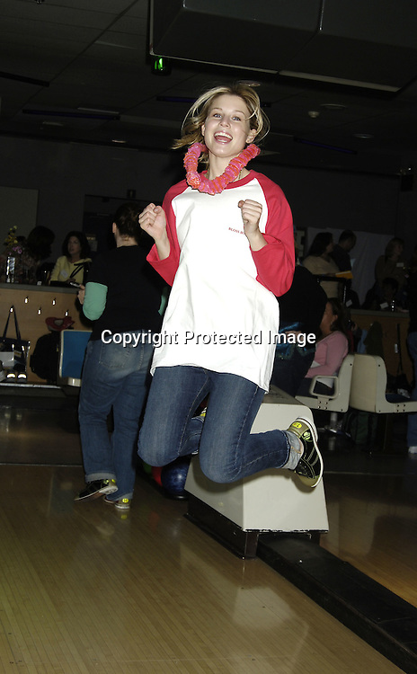 Stephanie Gatschet ..at The Guiding Light Bowling event hosted by Liz Keifer and Jerry verDorn at the Port Authority Bowling Ally on October 15, 2005. ..Photo by Robin Platzer, Twin Images