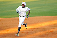 5 May 2012:  FIU outfielder Jabari Henry (14) runs the bases after hitting a two-run home run in the fourth inning as the FIU Golden Panthers defeated the Middle Tennessee State University Blue Raiders, 12-6, at University Park Stadium in Miami, Florida.