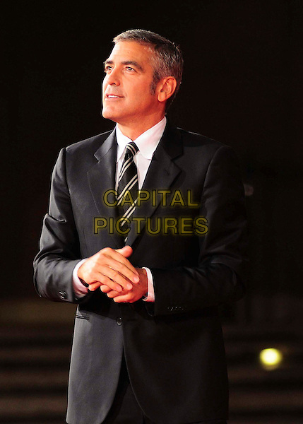 GEORGE CLOONEY .Attending 'Up In The Air' screening during the 4th Annual Rome International Film Festival, Rome, Italy.17th October 2009..half length  black striped tie white shirt suit jacket hands profile looking up .CAP/CAV.©Luca Cavallari/Capital Pictures