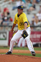 March 21, 2010:  Pitcher Kolby Wood (35) of the Michigan Wolverines delivers a pitch during a game at Tradition Field in St. Lucie, FL.  Photo By Mike Janes/Four Seam Images
