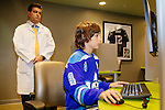 James Carswell, 13, takes an ImPACT test on a computer inside of the Concussion Clinic at the Providence St. Joseph Medical Center in Burbank, California November 17, 2015. Carswell received a concussion playing hockey and Dr. Michael Marvi treated him and used the ImPACT test to establish a baseline and to determine when he had healed and was fit to play again safely.