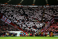 Charlton fans hold aloft white and red banners as the referee leads out the two teams during Charlton Athletic vs Doncaster Rovers, Sky Bet EFL League 1 Play-Off Football at The Valley on 17th May 2019