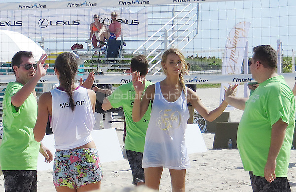 MIAMI, FL - FEBRUARY 20: Lauren Mellor and Kate Bock at the Sports Illustrated Swimsuit Beach Volleyball Tournament on Ocean Drive at Miami Beach on February 20, 2014 in Miami, Florida. Credit: mpi34/MediaPunch
