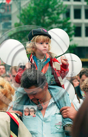 BRUSSELS - BELGIUM - 20 OCTOBER 1996--The biggest demonstration in the history of Belgium took place sunday in Brussels OKT. 20, 1996 for the victims of the pedofil Dutroux-gang. Here Julie Christaens sitting on her fathers shoulder.--PHOTO: EUP-IMAGES..