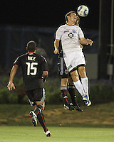 Carey Talley #8 of D.C. United up for a header against Jason Hotchkin #11 of the Harrisburg City Islanders during a US Open Cup match at the Maryland Soccerplex on July 21 2010, in Boyds, Maryland. United won 2-0.