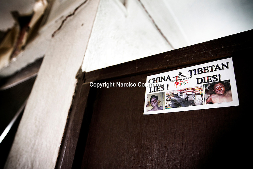 STICKER INTO THE ENTRANCE OF A HOUSE AT TIBETAN REFUGEE CAMP. KATHMANDU, NEPAL.