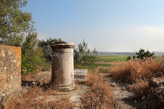 Ruins of the Temple of Athena, c. 300 BC, in the ruins of the Homeric city of Troy, Hill of Hissarlik, Turkey. The Mycenaean temple was surrounded by a Doric colonnade supporting a coffered ceiling and was built by Lysimachus, one of Alexander the Great's successors. In Greek and Roman times it was the site of the annual festival in honour of the goddess Athena. Troy was a city, both factual and legendary, in northwest Anatolia and was the setting of the Trojan Wars described in Homer's Iliad. This view looks across the Aegean plain to the Dardanelles Strait. Picture by Manuel Cohen
