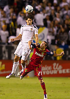 CARSON, CA - November 6, 2011: LA Galaxy defender Omar Gonzalez (4) and Real Salt Lake midfielder Luis Gil (21) during the match between LA Galaxy and Real Salt Lake at the Home Depot Center in Carson, California. Final score LA Galaxy 3, Real Salt Lake 1.