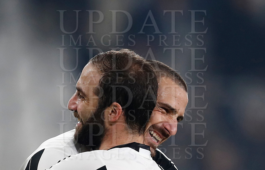 Calcio, Serie A: Juventus Stadium. Torino, Juventus Stadium, 29 ottobre 2016.<br /> Juventus Leonardo Bonucci, left, and Gonzalo Higuain celebrate at the end of the Italian Serie A football match between Juventus and Napoli at Turin's Juventus Stadium, 29 October 2016. Juventus won 2-1.<br /> UPDATE IMAGES PRESS/Isabella Bonotto