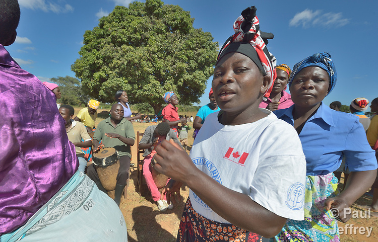Women sing and dance as part of an education program promoting proper prenatal care and maternal health in Kayeleka Banda, Malawi. The villagers get support from the Maternal, Newborn and Child Health program of the Livingstonia Synod of the Church of Central Africa Presbyterian.
