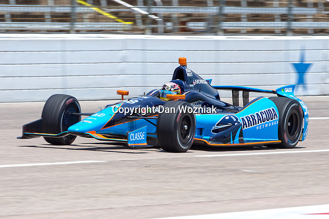 Alex Tagliani (98) driver for Bryan Herta Autosport with Curb-Agajanian in action during qualifying for the IZOD Indycar Firestone 550 race at Texas Motor Speedway in Fort Worth,Texas.