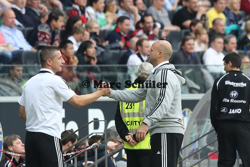 Interimstrainer Roger Prinzen (Nürnberg) feiert den Punktgewinn - Eintracht Frankfurt vs. 1. FC Nuernberg,