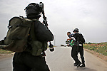 Israeli security forces detain a Palestinian protester during clashes following a protest marking the Palestinian Land Day in the West Bank village of Nabi Saleh near Ramallah, March 28, 2015. Land Day commemorates the unrest that erupted in March 1976 when Israeli Arabs protested the Israeli government's confiscation of thousands of acres of Arab-owned land and in which six Arab citizens were killed by Israeli police. Photo by Shadi Hatem