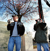 (L-R) Jeff Talley and George Taplin ( founder Herndon Minutemen).NoVa minutemen confront day laborers in a work pick site .Herndon, Va.12/1/05.photos: Hector Emanuel