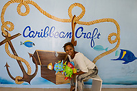 Haiti, Port-au-Prince, Caribbean Craft, artisans factory making products mostly in paper mache and metal work for export. Produce products for outlets such as Toms, and West Elm. Started and by Magalie Noel Dresse