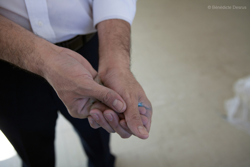 """Donovan disinfects his hands using his own homemade formula after carrying out the forensic cleaning of the scene of an unsolved homicide in Cuernavaca, Morelos – one of Mexico's most dangerous cities on August 7, 2015. The 66-year-old victim was a retired economics lecturer from the local university, and was killed in January of this year. The cleanup took place eight months later. The victim's family has since moved away to avoid further trouble. They remarked that justice is slow in Mexico and expressed dissatisfaction with the police investigation, but appreciated Donovan's discretion and professionalism. Donovan Tavera, 43, is the director of """"Limpieza Forense México"""", the country's first and so far the only government-accredited forensic cleaning company. Since 2000, Tavera, a self-taught forensic technician, and his family have offered services to clean up homicides, unattended death, suicides, the homes of compulsive hoarders and houses destroyed by fire or flooding. Despite rising violence that has left 70,000 people dead and 23,000 disappeared since 2006, Mexico has only one certified forensic cleaner. As a consequence, the biological hazards associated with crime scenes are going unchecked all around the country. Photo by Bénédicte Desrus"""