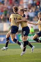 Carli Lloyd (United States, gold) celebrates her goal with Lori Chalupny (United States, gold). The United States defeated Norway, 1-0, in Rentschler Stadium, July 14, 2007.
