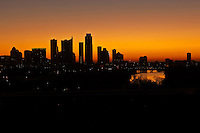 Silhouette of the downtown Austin, Texas, skyline's tall skyscapers at sunrise