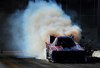 Mar. 12, 2011; Gainesville, FL, USA; NHRA funny car driver Cruz Pedregon does a burnout during qualifying for the Gatornationals at Gainesville Raceway. Mandatory Credit: Mark J. Rebilas-