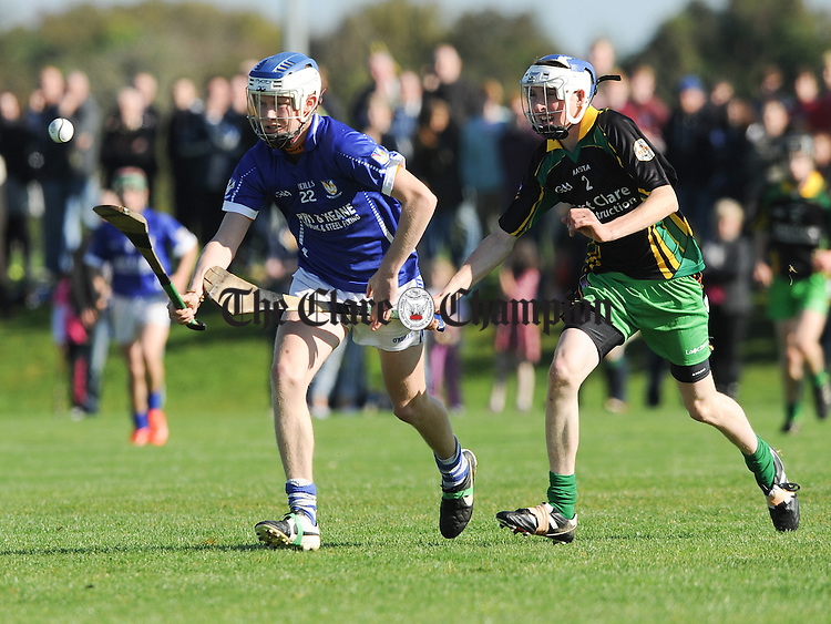 Aaron Slattery of Kilmaley in action against Michael Cotter of O Callaghan's Mills-Bodyke during their U-16A hurling final at Gurteen. Photograph by John Kelly.