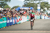 Picture by Alex Broadway/SWpix.com - 09/09/17 - Cycling - UCI 2017 Mountain Bike World Championships - XCO - Cairns, Australia - Nino Schurter of Switzerland celebrates as he crosses the line to win the Men's Elite Cross Country Final.