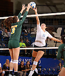 BROOKINGS, SD - OCTOBER 26:  Wagner Larson #11 from South Dakota State tips the ball against Emily Minnick #3 from North Dakota State in the third game of their match Saturday evening at Frost Arena in Brookings. (Photo by Dave Eggen/Inertia)