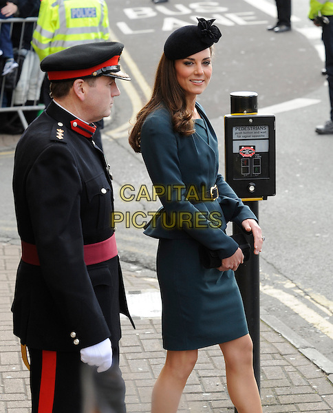 Catherine, Duchess of Cambridge (Kate Middleton).Accompanies the Royal family during their visit to Leicester, on first date of Queen Elizabeth II's Diamond Jubilee tour of the UK, England, UK,.March 8th 2012..half 3/4 length green teal LK Bennett dress peplum jacket princess black hat green side belt  royalty .CAP/DH.©David Hitchens/Capital Pictures.