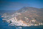 Rugged hills and rocky coastline and blue sky near Little Harbor, Catalina Island coast, California