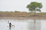 Manyok Garang, 11, catches fish in Poktap, a town in South Sudan's Jonglei State where conflict, drought and inflation have caused severe food insecurity. The Lutheran World Federation, a member of the ACT Alliance, is helping families tackle food problems, including by providing cash for the purchase of fishing line and hooks. This boy's family fled the region when war broke out in 2013, living as internally displaced elsewhere in the country until returning in 2016.<br /> <br /> Parental consent obtained.