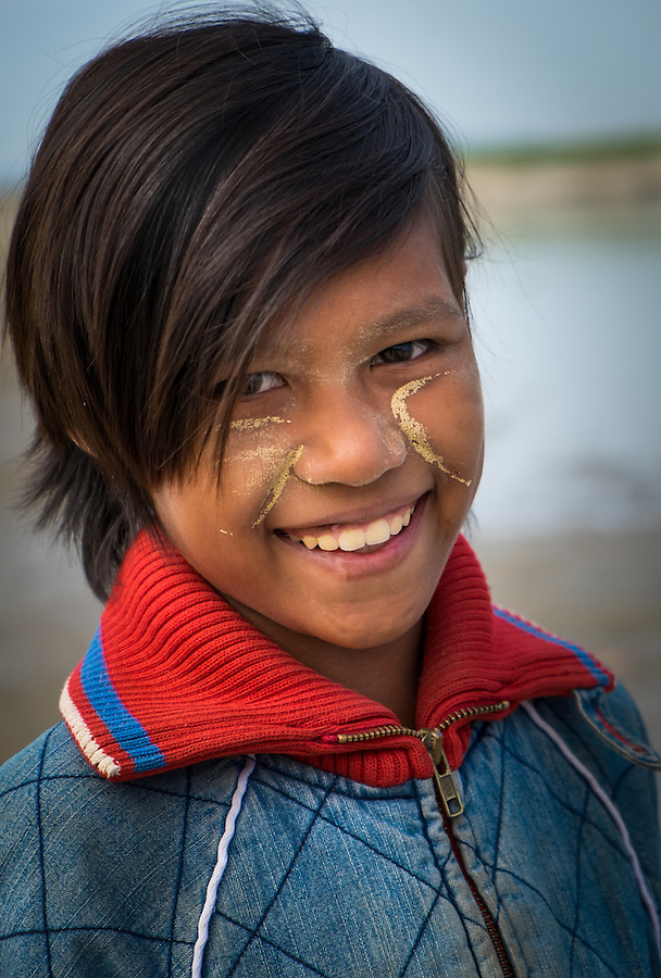 BAGAN, MYANMAR - CIRCA DECEMBER 2013: Portrait of young Burmese girl smiling in Bagan