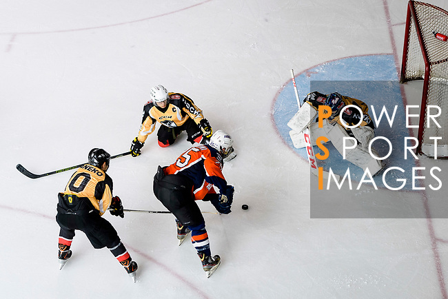 Rob Martini of Singapore Hawkers (C) battle in the goal mouth with Empire Goalie Eri Kiribuchi (R) during the Mega Ice Hockey 5s match between Singapore Hawkers and Empire Skate on May 04, 2018 in Hong Kong, Hong Kong. Photo by Marcio Rodrigo Machado / Power Sport Images