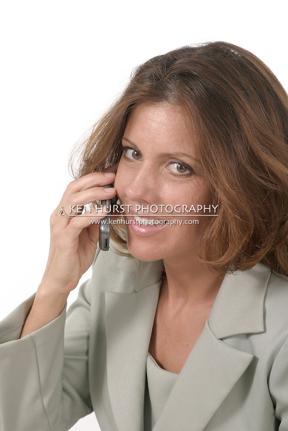 Attractive and beautiful executive business woman talking on cellphone.