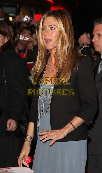 """JENNIFER ANISTON.""""Marley & Me"""" UK film premiere held at Vue cinema, Leicester Square, London, England..March 2nd, 2009. .half length blue dress gold necklaces chains silk beige grey gray georgette bracelets black jacket blazer rings mouth open .CAP/ROS.©Steve Ross/Capital Pictures."""