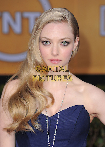 Amanda Seyfried (wearing Zac Posen).Arrivals at the 19th Annual Screen Actors Guild Awards at the Shrine Auditorium in Los Angeles, California, USA..27th January 2013.SAG SAGs headshot portrait navy blue  necklace medallion silver strapless .CAP/DVS.©DVS/Capital Pictures.
