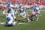 UK's Randall Cobb runs the ball against the University of Louisville at Papa John's Cardinal Stadium on Saturday, Sept. 4, 2010. Photo by Scott Hannigan | Staff